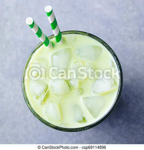 Matcha green tea ice latte in a glass. Grey stone background. Top view. - csp69114896