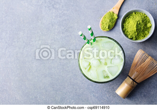 Matcha ice green tea in glass. Grey stone background. Top view. Copy space. - csp69114910