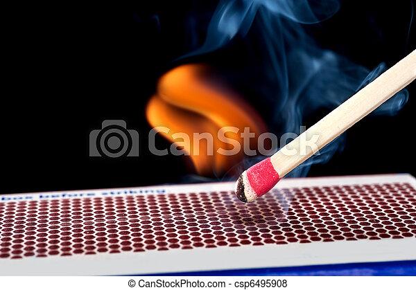 Matchstick on fire - csp6495908