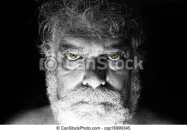 Mature bearded man with angry face staring - csp16999345