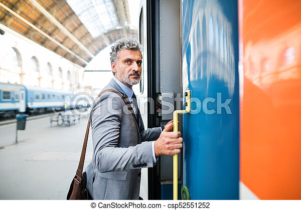 Mature businessman on a train station. - csp52551252