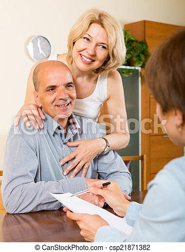 Mature couple filling questionnaire - csp21871382