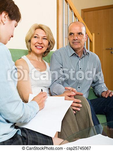 Mature couple filling questionnaire - csp25745067