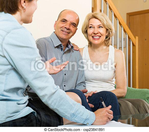 Mature couple filling questionnaire - csp23841891