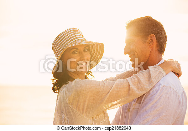 Mature Couple in Love on the Beach at Sunset - csp21882643