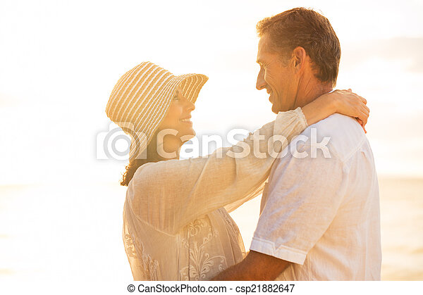 Mature Couple in Love on the Beach at Sunset - csp21882647