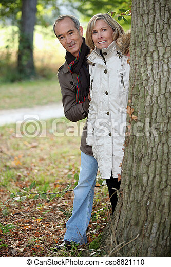 Mature couple out for an autumn stroll - csp8821110