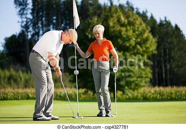 Mature couple playing Golf - csp4327781