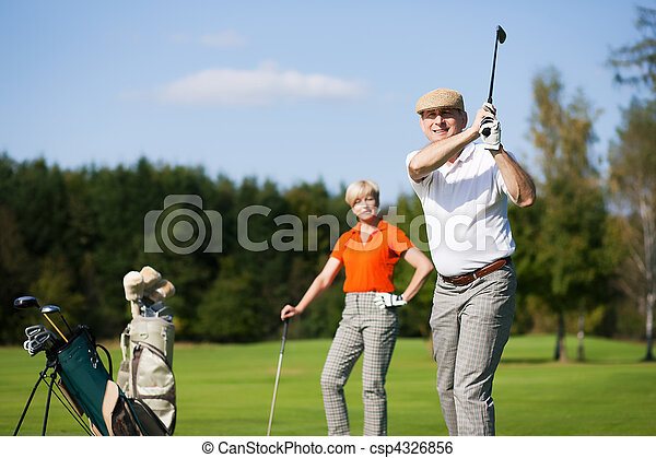 Mature couple playing Golf - csp4326856