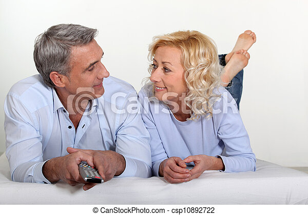 Mature couple watching television - csp10892722