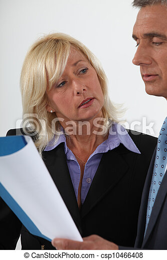 Mature couple with a report - csp10466408