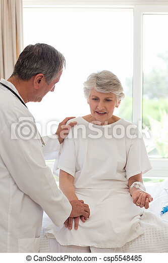 Mature doctor with his patient - csp5548485