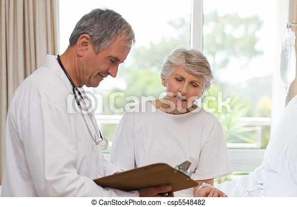 Mature doctor with his patient - csp5548482