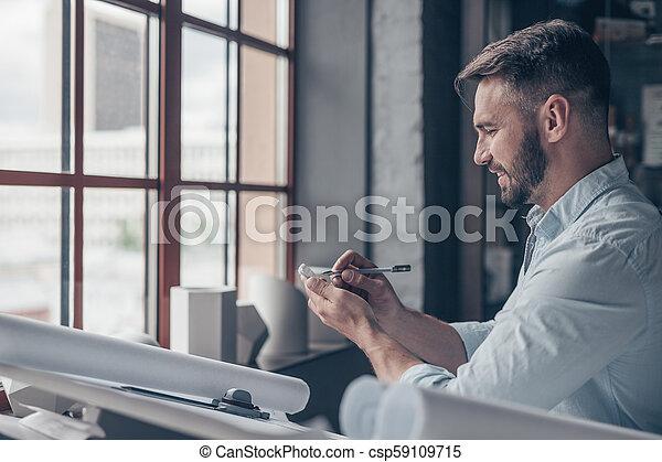Mature man at work - csp59109715