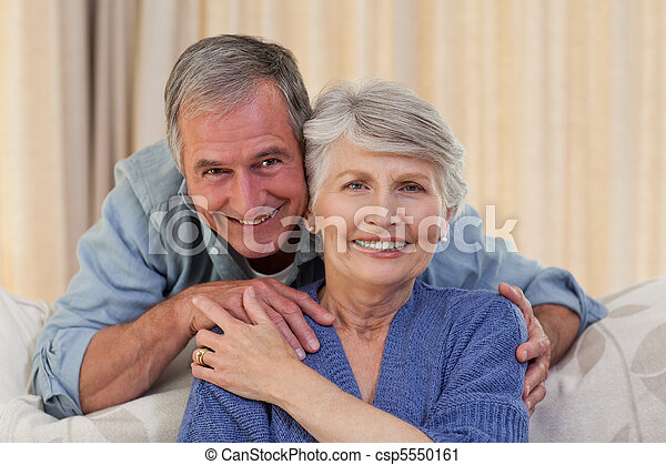 Mature man hugging his wife - csp5550161