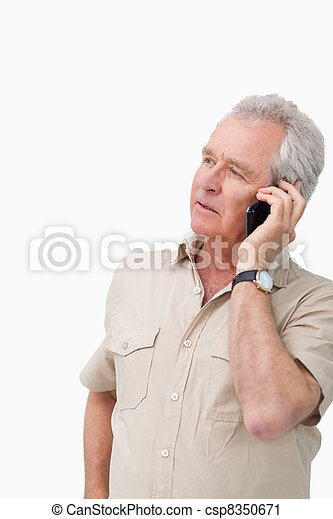 Mature man talking on his mobile phone - csp8350671