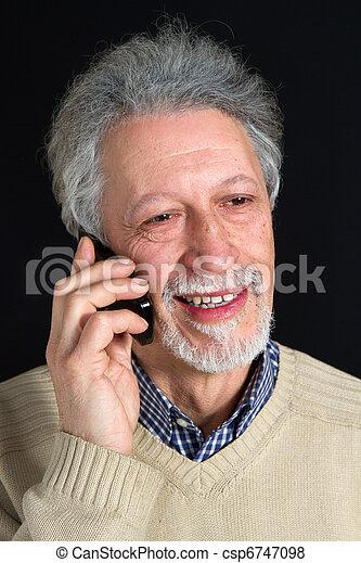 mature man talking on his mobile phone  - csp6747098