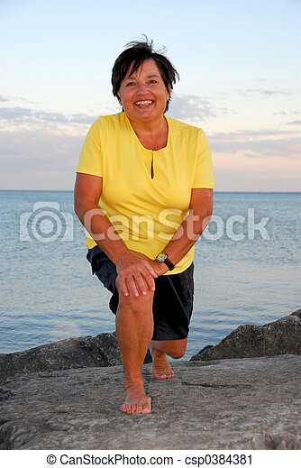 Mature woman exercising - csp0384381