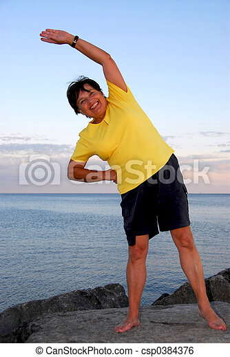 Mature woman exercising - csp0384376