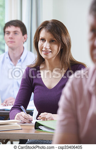 Mature Woman In Adult Education Class - csp33406405