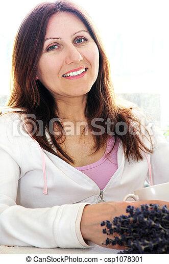 Mature woman relaxing - csp1078301