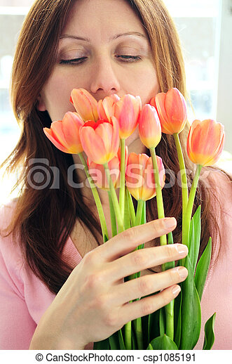 Mature woman with flowers - csp1085191
