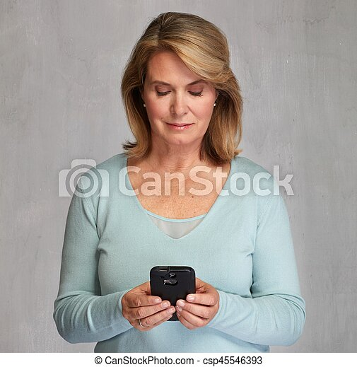 Mature woman with smartphone - csp45546393