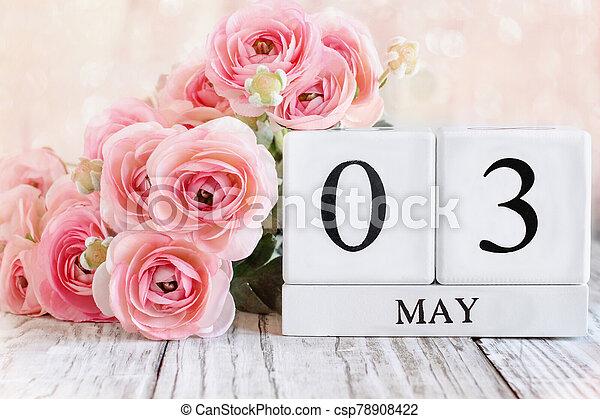 May 3 Calendar Blocks with Pink Ranunculus - csp78908422