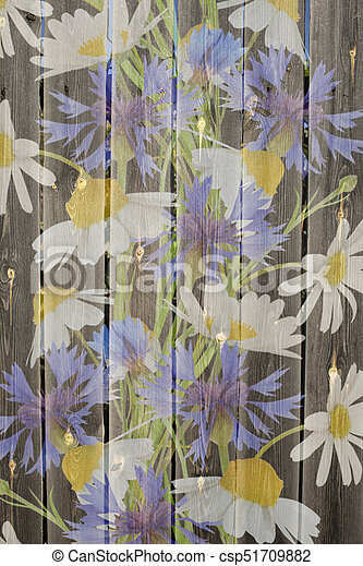 Meadow flowers on a wood background - csp51709882