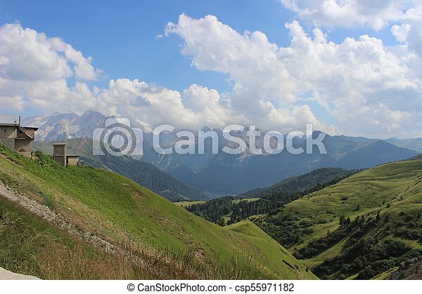 Meadow in the mountains on a sunny day - csp55971182