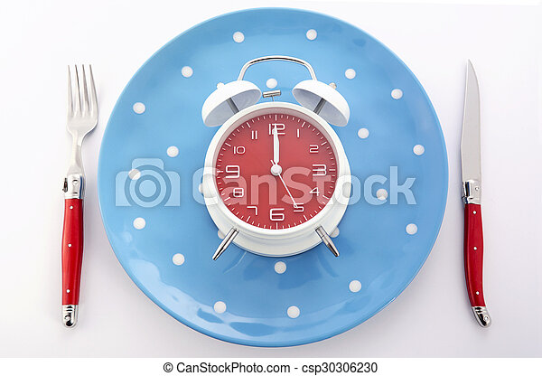 Mealtime table place setting with alarm clock - csp30306230