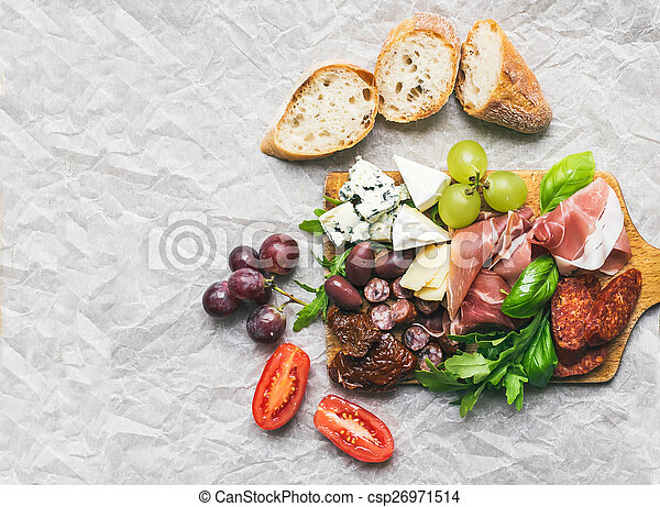Meat and cheese plate on rustic wood board over a white paper ba - csp26971514 & Meat and cheese plate on rustic wood board over a white... stock ...