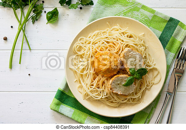 Meat balls turkey with cauliflower in tomato sauce and spaghetti on a wooden table. Copy space, top view flat lay background. - csp84408391