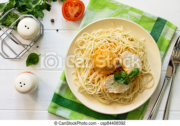 Meat balls turkey with cauliflower in tomato sauce and spaghetti on a wooden table. Top view flat lay background. - csp84408392
