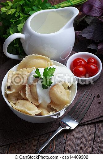 Meat dumplings with sour cream, traditional pelmeni or varenyky dish - csp14409302