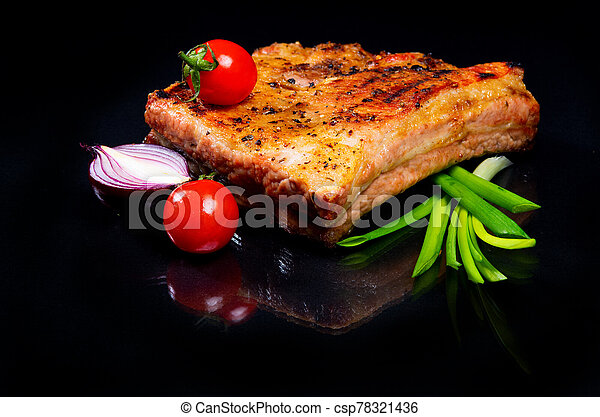 Meat with ribs on a black background. - csp78321436