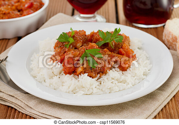 meatballs with boiled rice on the white plate - csp11569076