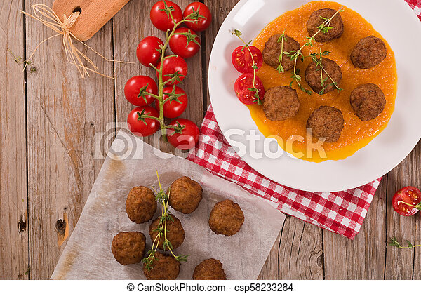 Meatballs with carrot pure. - csp58233284