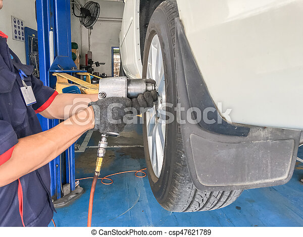 Mechanic changing a tire - csp47621789