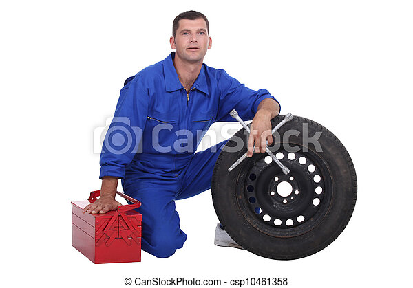 mechanic changing a tire - csp10461358