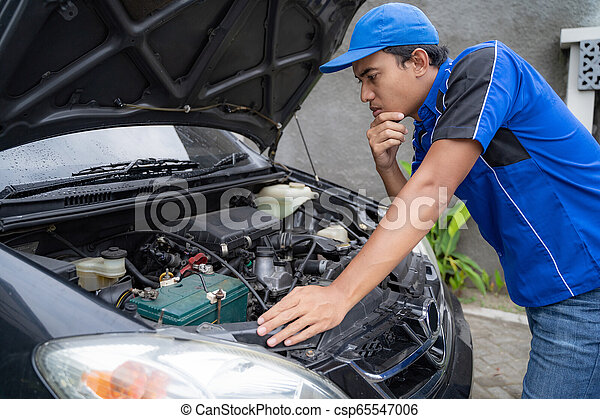 Home Service Mechanic Doing Some Inspection On Car S Engine Canstock