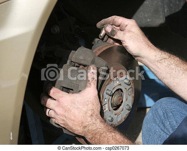 Mechanic Hands On Brakes - csp0267073