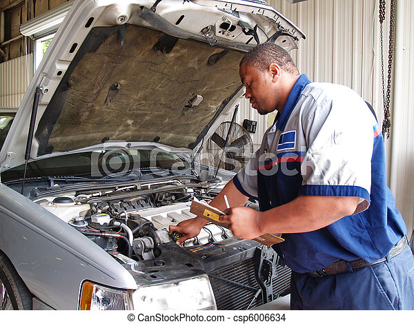Mechanic Performing a Routine Servi - csp6006634