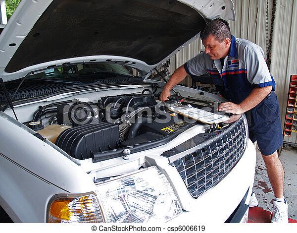 Mechanic Performing a Routine Servi - csp6006619
