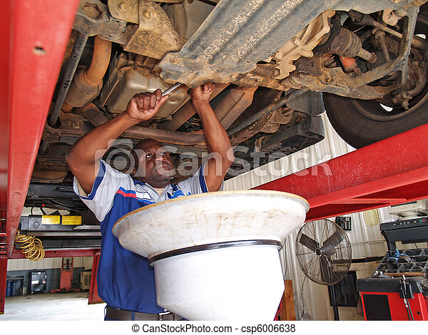Mechanic Performing an Oil Change - csp6006638