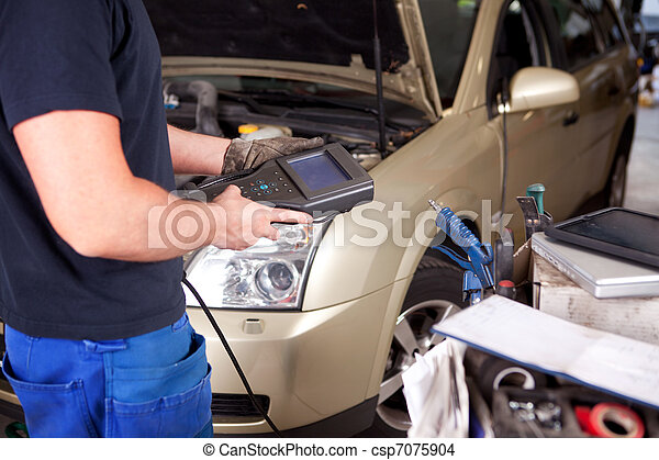 Mechanic with Diagnostic Equipment - csp7075904