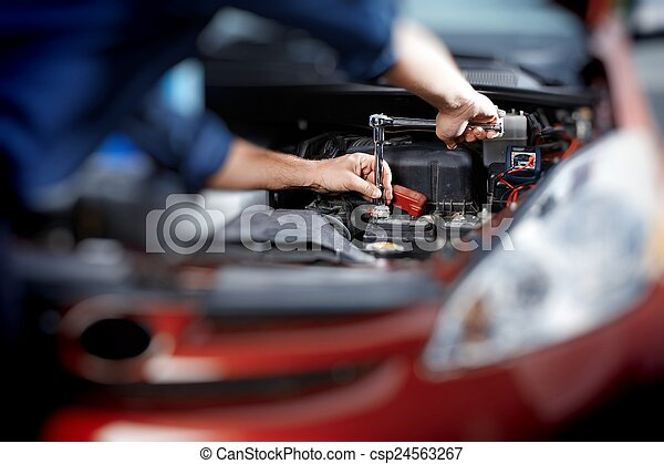 Mechanic working in auto repair garage - csp24563267