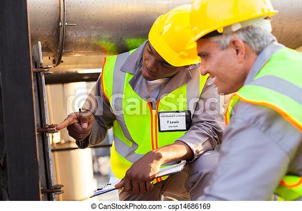 mechanical engineers working on fuel pipeline - csp14686169