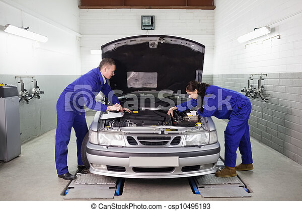 Mechanics looking at the engine - csp10495193