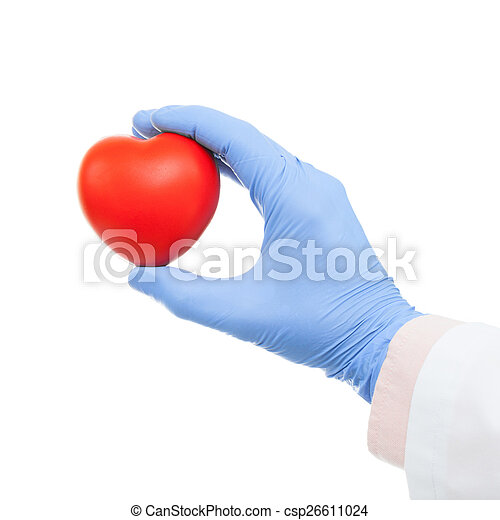 Medical doctor holding heart shaped toy in hand - studio shot - csp26611024